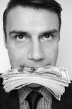 Uomo d'affari con il pacchetto dei dollari in una bocca Fotografia Stock Libera da Diritti