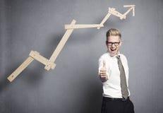 Uomo d'affari con il pollice su. Immagini Stock