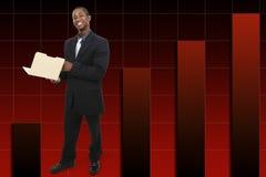Uomo d'affari con il pollice in su sopra i cenni storici aumentanti del grafico. Fotografia Stock Libera da Diritti