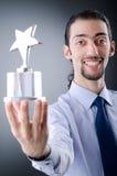 Uomo d'affari con il premio della stella Fotografie Stock Libere da Diritti