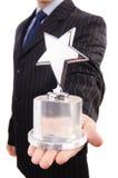 Uomo d'affari con il premio della stella Immagini Stock Libere da Diritti