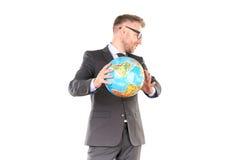 Uomo d'affari con il puzzle del globo 3D Immagine Stock