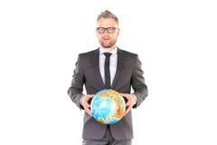 Uomo d'affari con il puzzle del globo 3D Immagini Stock Libere da Diritti