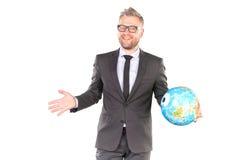 Uomo d'affari con il puzzle del globo 3D Fotografie Stock Libere da Diritti