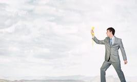 Uomo d'affari con il ricevitore giallo Fotografia Stock Libera da Diritti