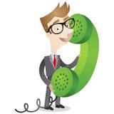 Uomo d'affari con il ricevitore telefonico verde illustrazione di stock