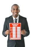 Uomo d'affari con il segno di orari di esercizio Fotografia Stock Libera da Diritti