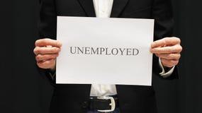 Uomo d'affari con il segno disoccupato immagine stock