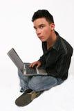 Uomo d'affari con il suo computer portatile Fotografia Stock Libera da Diritti