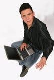 Uomo d'affari con il suo computer portatile Immagine Stock Libera da Diritti