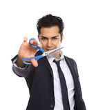 Uomo d'affari con il taglio delle forbici Immagine Stock