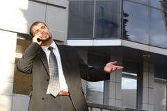 Uomo d'affari con il telefono Fotografia Stock