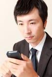 Uomo d'affari con il telefono astuto Fotografie Stock Libere da Diritti