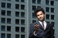 Uomo d'affari con il telefono mobile fotografie stock