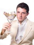 Uomo d'affari con il vetro di cocktail in pieno delle banconote Immagine Stock Libera da Diritti