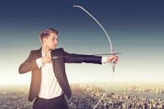 Uomo d'affari con l'arco fotografia stock libera da diritti