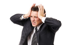 Uomo d'affari con l'emicrania severa Immagini Stock
