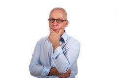 Uomo d'affari con l'espressione premurosa Fotografie Stock