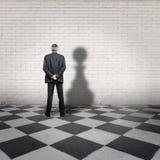 Uomo d'affari con l'ombra del pegno Immagine Stock Libera da Diritti