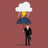 Uomo d'affari con l'ombrello in tempesta Fotografia Stock