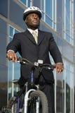 Uomo d'affari con la bicicletta Immagini Stock