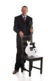 Uomo d'affari con la chitarra immagine stock