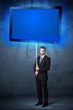 Uomo d'affari con la compressa brillante Fotografia Stock
