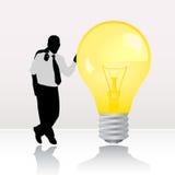 Uomo d'affari con la lampadina   Immagine Stock