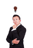 Uomo d'affari con la lampadina del caffè sopra la sua testa Fotografie Stock