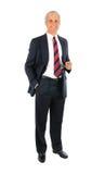 Uomo d'affari con la mano in casella e vetri Immagine Stock