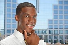 Uomo d'affari con la mano sul mento Fotografia Stock Libera da Diritti