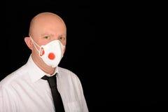 Uomo d'affari con la mascherina Fotografia Stock Libera da Diritti
