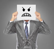 Uomo d'affari con la mascherina arrabbiata Fotografia Stock