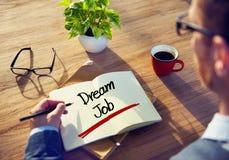 Uomo d'affari con la nota circa Job Concept di sogno fotografia stock