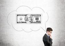 Uomo d'affari con la nuvola della bolla del dollaro Fotografia Stock Libera da Diritti