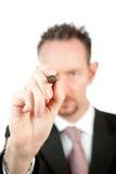 Uomo d'affari con la penna di indicatore nera Immagini Stock Libere da Diritti