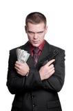 Uomo d'affari con la pistola ed i soldi Fotografia Stock