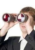 Uomo d'affari con la ricerca del binocolo Fotografie Stock Libere da Diritti