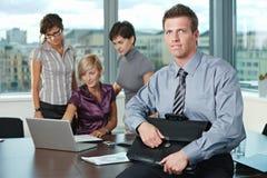 Uomo d'affari con la squadra Immagine Stock