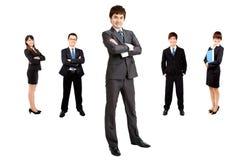 Uomo d'affari con la squadra di affari fotografia stock libera da diritti