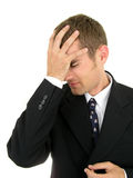 Uomo d'affari con la sua mano sulla sua testa Immagine Stock