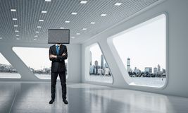 Uomo d'affari con la TV invece della testa Immagini Stock