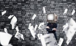 Uomo d'affari con la vecchia TV invece della testa Fotografia Stock Libera da Diritti