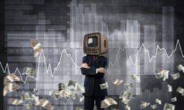 Uomo d'affari con la vecchia TV invece della testa Immagine Stock Libera da Diritti