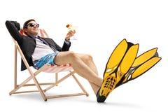 Uomo d'affari con le alette ed il cocktail di nuoto Fotografia Stock Libera da Diritti