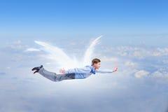 Uomo d'affari con le ali di angelo fotografia stock libera da diritti
