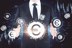 Uomo d'affari con le euro icone immagine stock libera da diritti