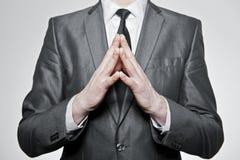 Uomo d'affari con le mani piegate insieme Fotografie Stock Libere da Diritti