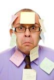 Uomo d'affari con le note appiccicose Fotografie Stock