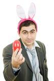Uomo d'affari con le orecchie di coniglio Fotografia Stock
